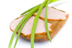 Ham sandwich. A sandwich with two slices of ham and green onions on rye bread, white background stock image