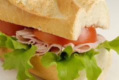 Ham Sandwich. Sandwich made from French Bread filled with ham, lettice and tomato stock photo