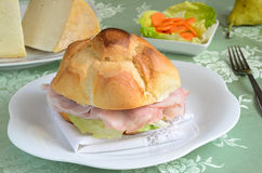 Ham sandwich. Sandwich stuffed with ham and vegetables Royalty Free Stock Photography