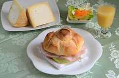 Ham sandwich. Sandwich stuffed with ham and vegetables Royalty Free Stock Photo