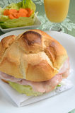 Ham sandwich. Sandwich stuffed with ham and vegetables Stock Image