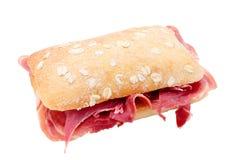 Ham sandwich. Snack of serrano ham of jabugo trimmed and isolated Royalty Free Stock Image