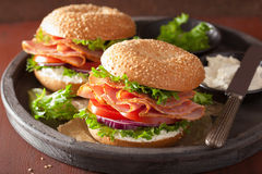 Ham sandwich on bagel with cream cheese tomato onion Stock Photography