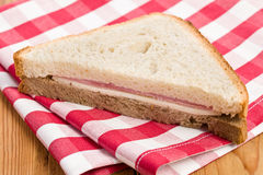 Ham sandwich on checkered napkin Royalty Free Stock Photography