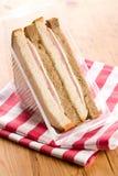 Ham sandwich on checkered napkin Royalty Free Stock Photo