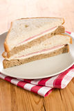 Ham sandwich on checkered napkin Royalty Free Stock Image