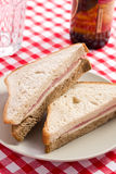 Ham sandwich on checkered tablecloth Royalty Free Stock Images