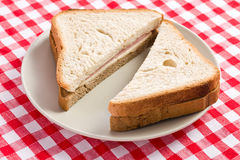 Ham sandwich on checkered tablecloth Stock Image