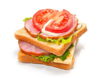 Ham sandwich with cheese, tomatoes and lettuce Royalty Free Stock Photography