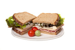 Ham sandwich and cherry tomatoes. Royalty Free Stock Image