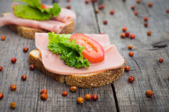 Ham Sandwich. Delicious ham sandwiches on wooden textured background Royalty Free Stock Photo