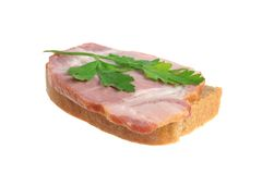 A ham sandwich with green leaf of parsley isolated on white Royalty Free Stock Photography