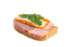 A ham sandwich with lard and green leaf of parsley isolated on w Stock Image