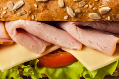 Ham sandwich. With lettuce, cheese, tomato close up Royalty Free Stock Photos