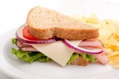 Ham sandwich platter with potato chips. Delicious ham sandwich platter with whole wheat bread and potato chips Royalty Free Stock Image
