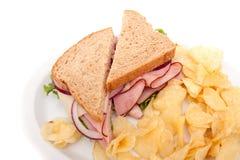 Ham sandwich platter with potato chips Stock Images