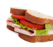 A ham sandwich on wheat on a white background Royalty Free Stock Image