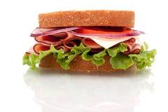 Ham sandwich on whole wheat bread Royalty Free Stock Photos