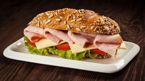 Ham sandwich on wooden background Stock Photography