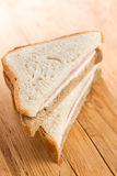 Ham sandwich on wooden table Royalty Free Stock Photo