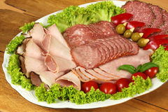 Ham and sausage on banquet dish Royalty Free Stock Images
