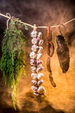 Ham, sausage and garlic in a smokehouse Stock Photo