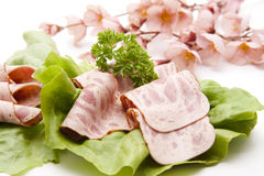 Ham sausage on lettuce leaf Stock Photos