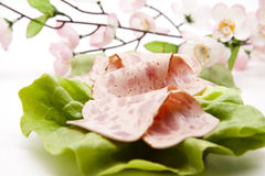 Ham sausage on lettuce leaf Royalty Free Stock Photo