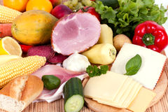 Ham with sausage and mixed fruits and vegetables Royalty Free Stock Images