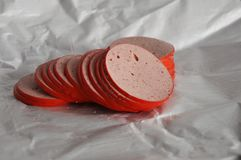 Ham sausage slices. Ham sausage on the paper from the butcher Stock Photo