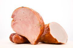 Ham and sausage on a wooden board Royalty Free Stock Photo