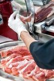 Ham slicer with prosciutto ham Royalty Free Stock Image