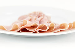 Ham slices arranged on a plate, detail Royalty Free Stock Photos