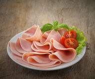 Ham slices on plate Stock Photography