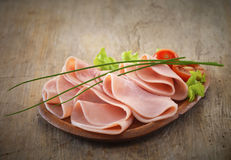 Ham slices on plate Royalty Free Stock Image