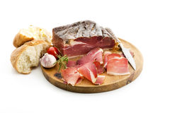 Ham from South-Tirol served on wooden board against white background Royalty Free Stock Photo