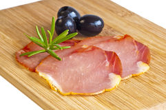Ham of Spain Lomo. With rosemary and olives Stock Image