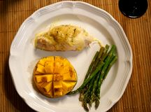 Ham stuffed chicken, low carb, paleo diet dinner. Stuffed chicken, mango, and asparagus low carb dinner can be visually appealing as well as healthy and stock image