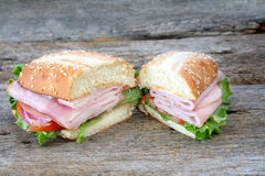 Ham Sub. /hoagie with all the fixings and cut in two.  Room for copy space Royalty Free Stock Photo