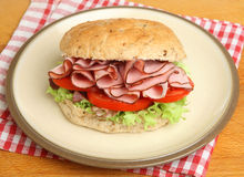 Ham & Tomato Roll Sandwich on Plate Stock Photo