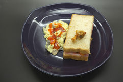 Ham and tomato sandwich with scrambled egg. In dish Stock Image