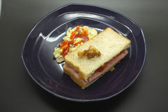 Ham and tomato sandwich with scrambled egg. In dish Royalty Free Stock Image