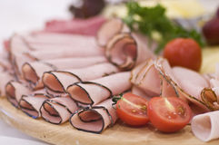 Ham and tomatoes board Stock Photography