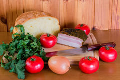 Ham, tomatoes and onion. Selective focus Royalty Free Stock Images