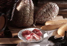 Typical whole Culatello with some slices. Typical ham produced in Parma and plate of sliced stock photography