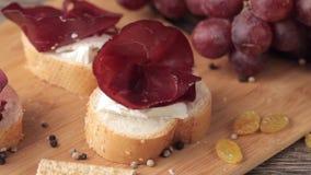 Ham, white cheese and grape stock video