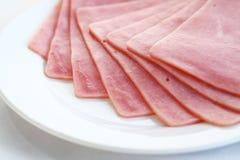 Ham on white dish. Slices of tasty ham ,on white dish Royalty Free Stock Photos