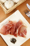 ham on a white plate with fork and knife Royalty Free Stock Photo
