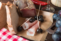 Ham, wine and bread Stock Photography