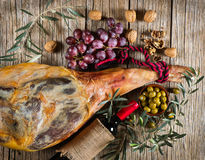 Ham, wine, grapes and olives, top view Royalty Free Stock Image